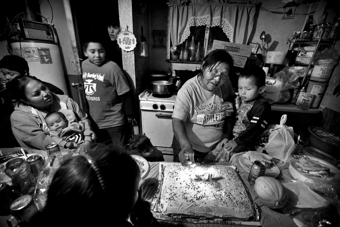 """Irene George holds her Grandson, Ilandric Begay while her Daughter, Denise Almeida, holds her newborn, Leon Zepeda, as they celebrate a family birthday. No matter the hardship, Irene says """"our family is what keeps us together in the hard times"""" Many say they didn't understand the details of the Freeze and didn't know its boundaries. Some people, like the George Family, who live not far from Tuba City, don't even know whether or not they live on the Freeze."""