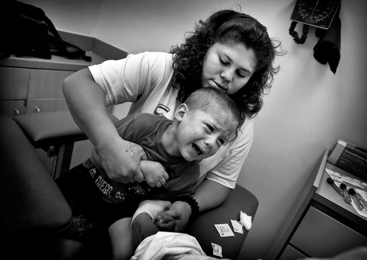 Several weeks after the shooting, Josue struggles as a nurse prepares to draw blood. Doctors recommended intensive therapy in order to train the healthy part of Josue's brain to take over functions previously performed by the now-wounded part.