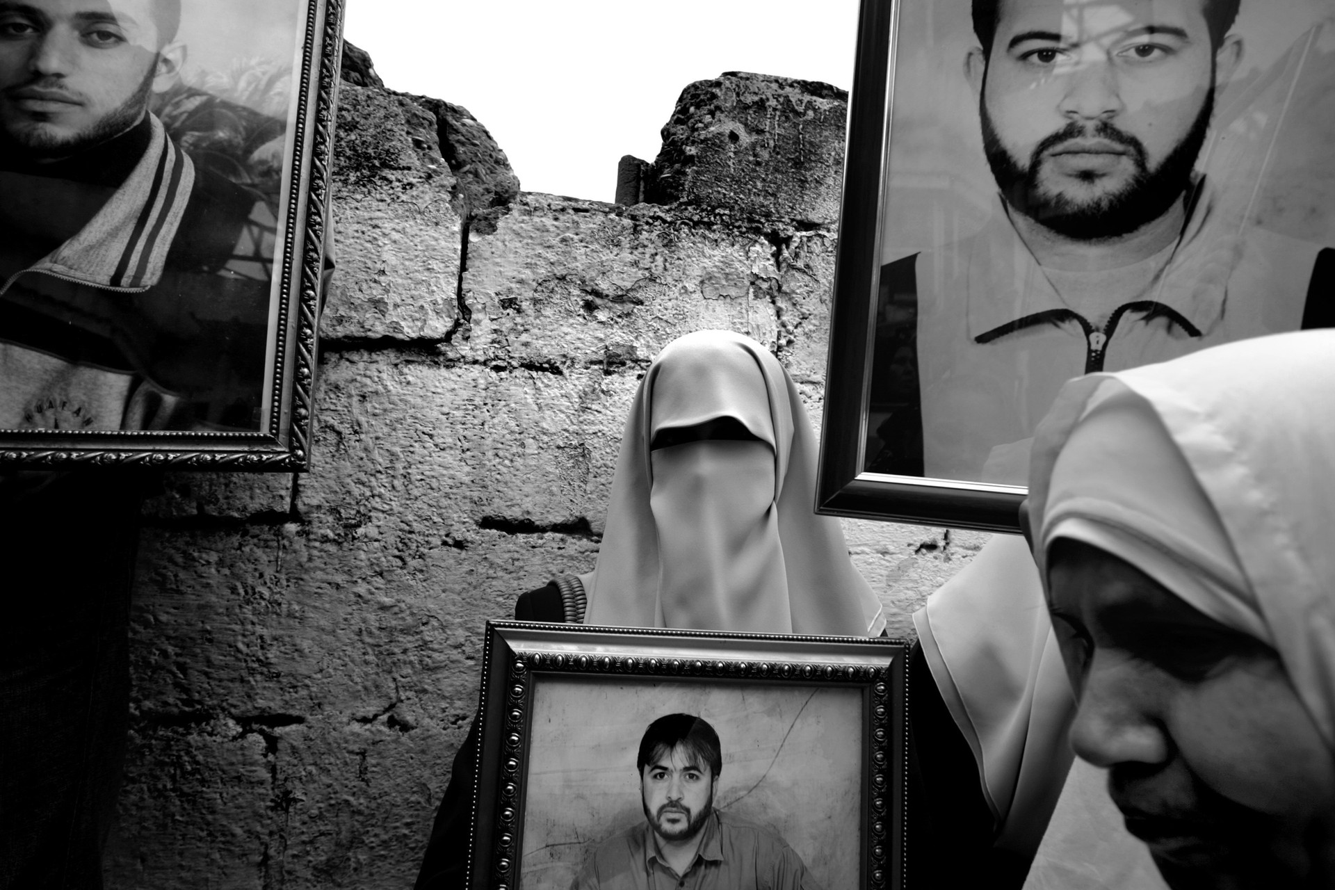 Palestinian women hold framed photographs of their loved ones during a demonstration in Gaza City demanding the release of Palestinian prisoners being held in Israeli jails. Some 8,000 Palestinians are in Israeli jails, leaving thousands of virtual widows.