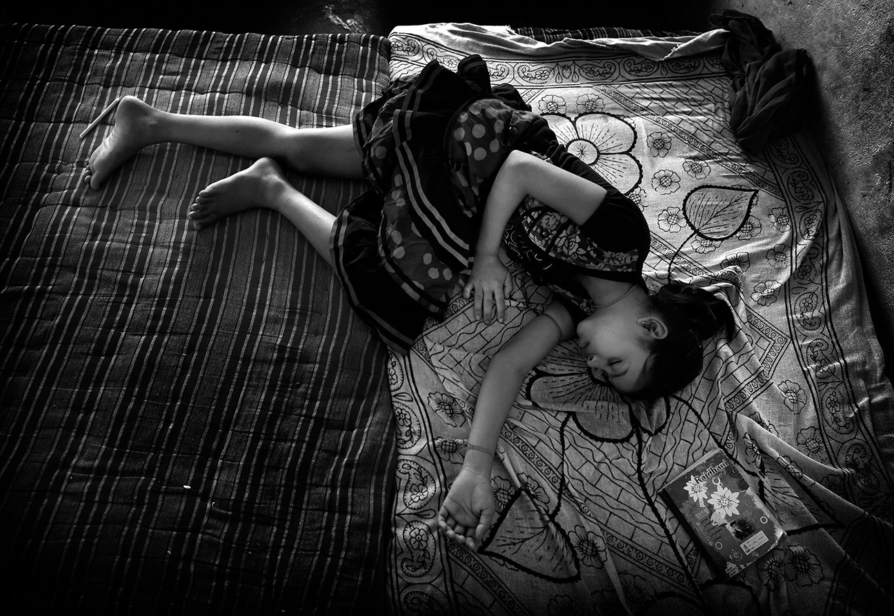 Sabhyata, 12, sleeps after reading a book. Many girls girls iwho come from low caste communities  India are sex trafficked as young as 8 years old. The school offers an opportunity for girls of low and high caste to develop friendship outside of caste rules.