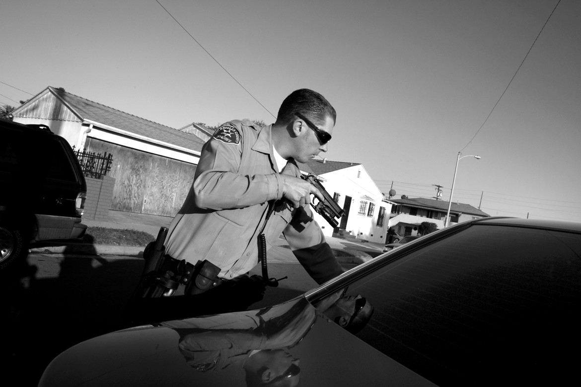 In L.A. County homicides fell by nearly a fifth in the first half of 2010, but violence, especially gun violence, remains a plague. Los Angeles County Sheriff's Deputy Derek Fender pulls over a suspected gang member during a patrol.