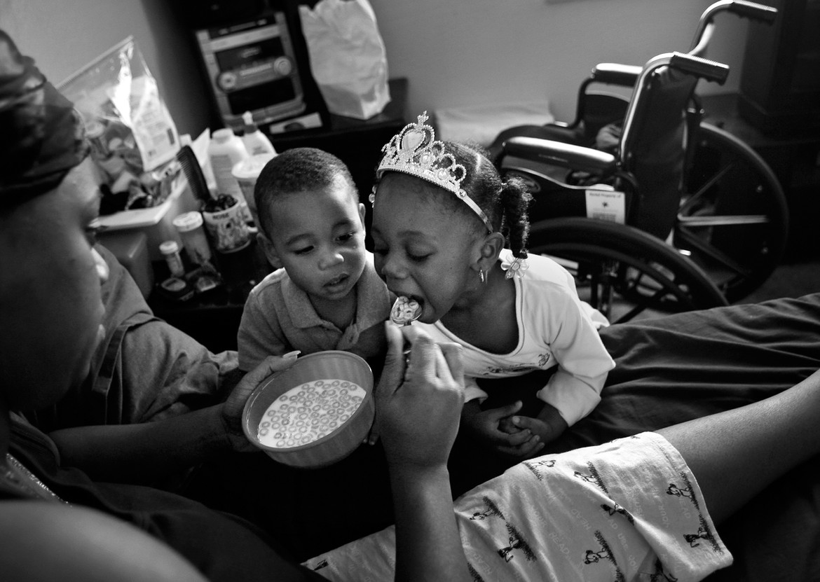 """Smith tries to maintain some routine for the children despite her paralysis and feeds Tyrin and Mariah from her bedside. When the alarm goes off in the morning, Rose pushes herself to get out of bed. """"Put the pain behind you, put the misery behind you,"""" Rose says. """"You want the kids to be in a good mood when they get ready to go to school, so, 'Good morning, kids.  Come in the bathroom;  wash your face;  brush your teeth;  be good;  listen to the teacher.'"""""""
