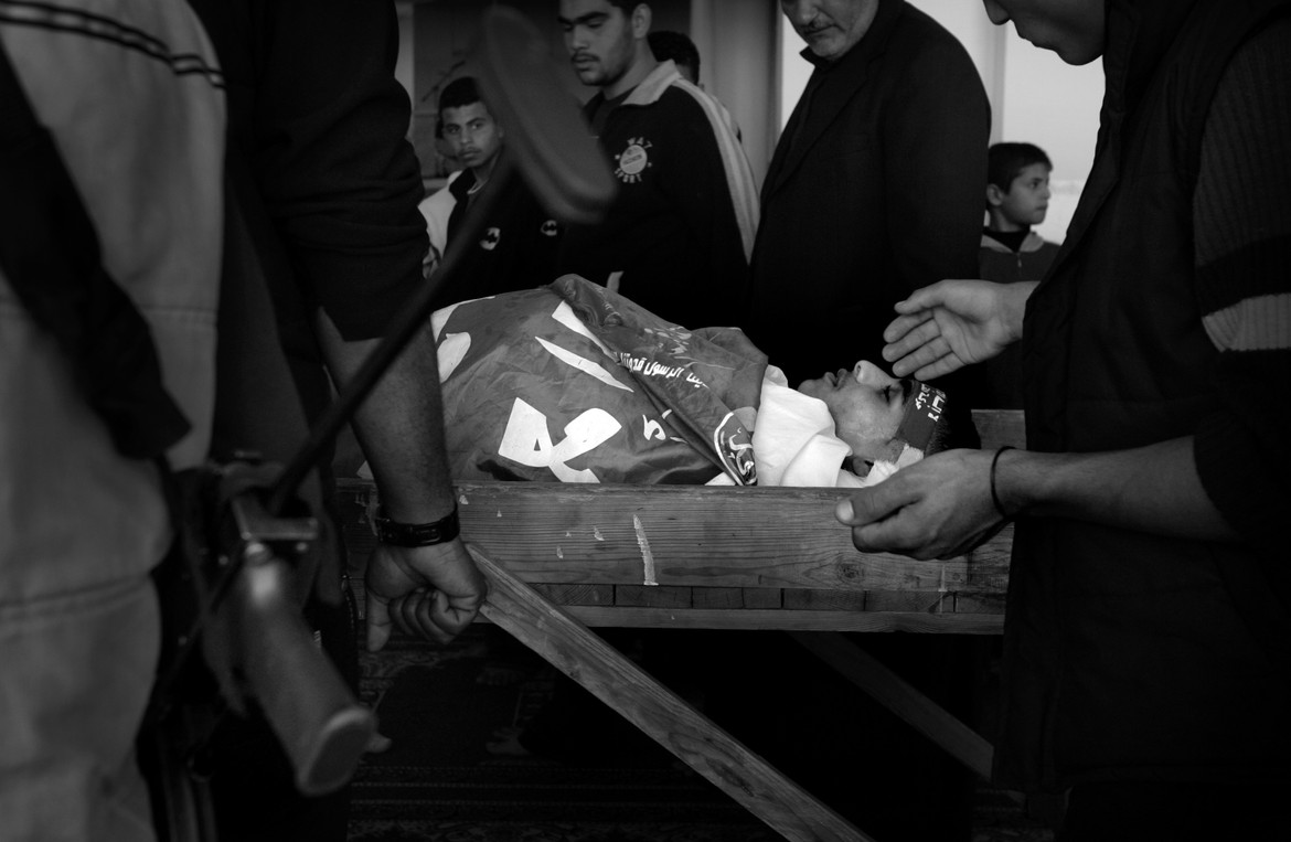 The body of Mamdoh Abaid, 17, rests in a Gaza City mosque at a martyr's funeral provided by Hamas. The cult of martyrdom has led many frustrated young Palestinians to take up the gun.