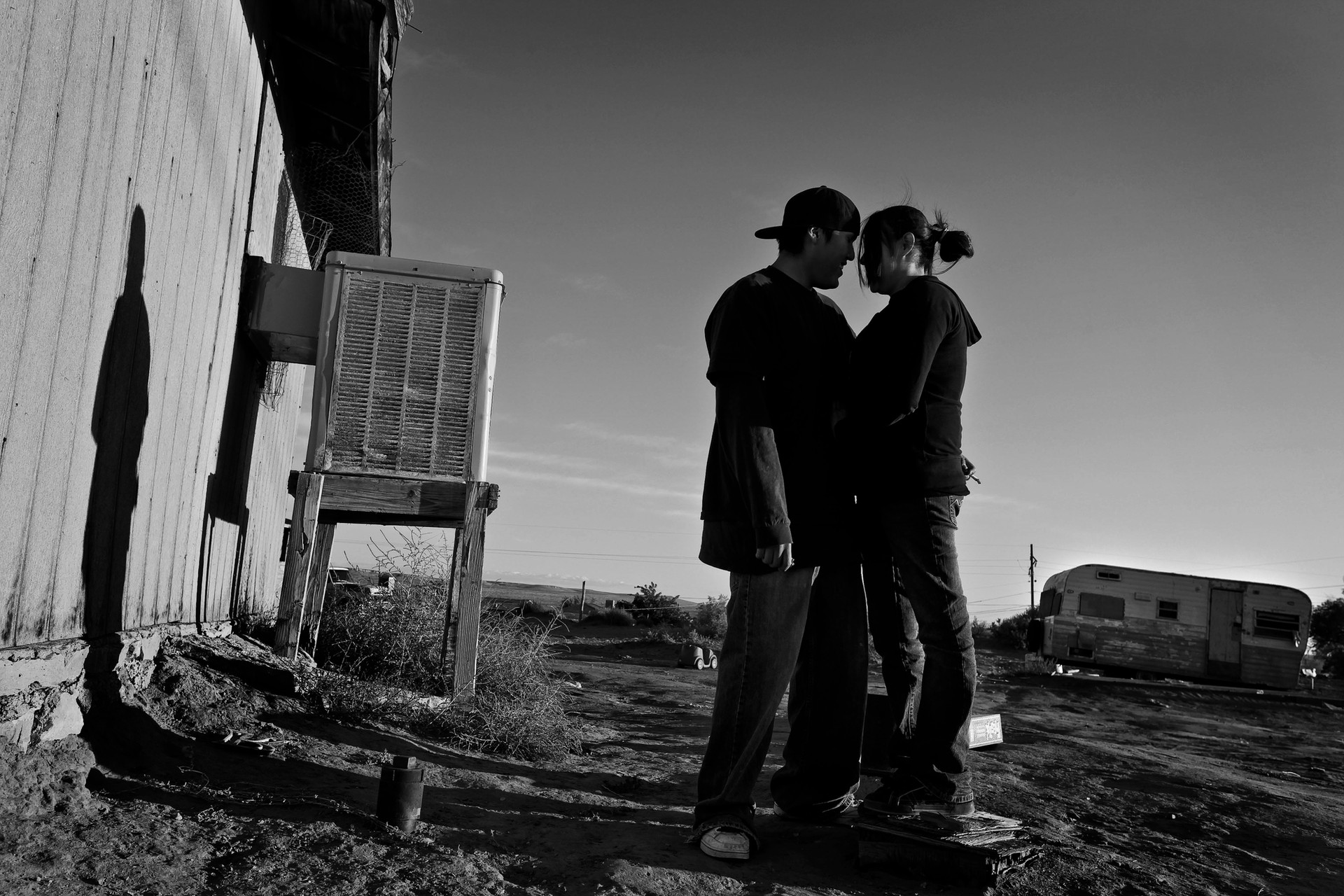 Michael and Sarah share a moment alone during a family gathering on the reservation.