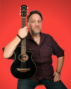 Portrait of Mitch holding a black acoustic guitar and link to his bandcamp page, against a red background