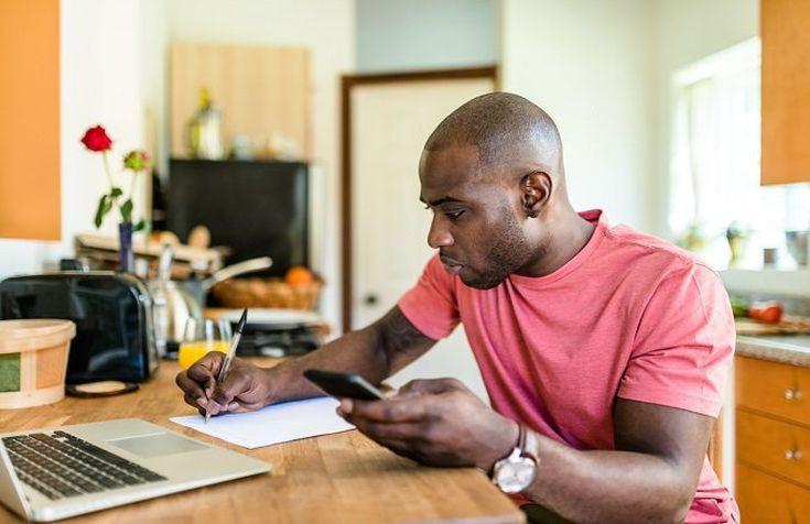black man budgeting money
