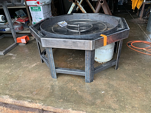 """Finished frame of new firepit with 30"""" fire ring attached."""