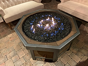 Firepit at night set on low.