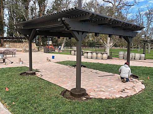 Finishing edge brick work under pavilion.