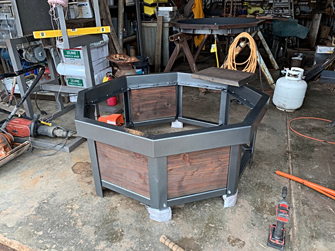 Laying in redwood panels into firepit