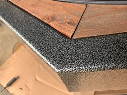 Close up of silver and black antique powdercoating.