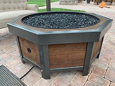 Finished firepit with black mirror glass fill.