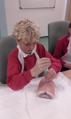Giving an injection!