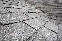 Old roof with hail damage, chalk circles