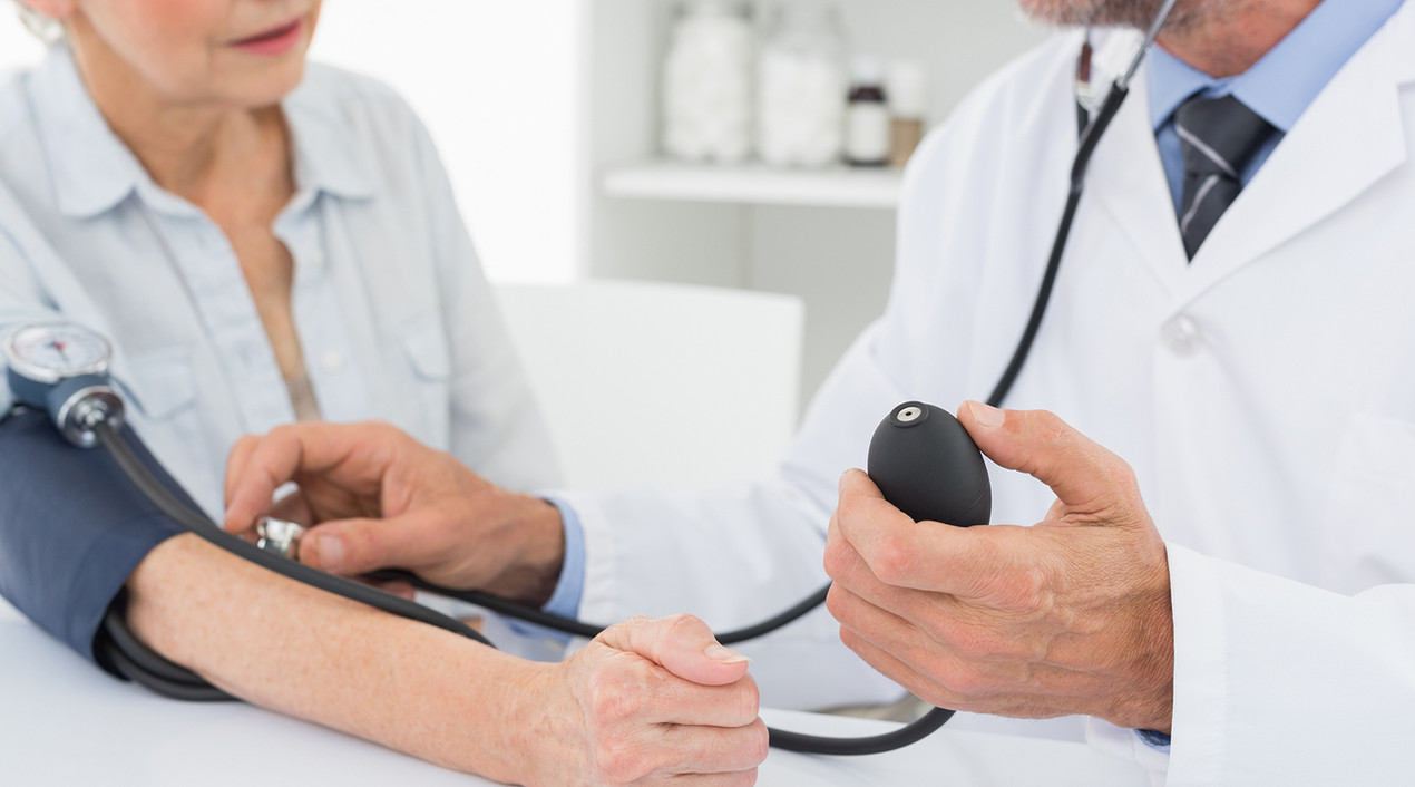 woman gets her blood pressure taken
