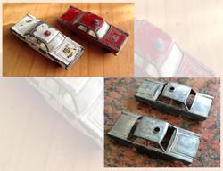 Stripped vintage police cars for restoration.