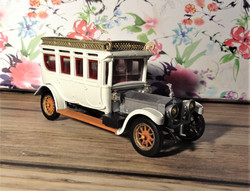Car, Rolls royce 1912 model car, vintage toy car. Corgi car, Resprayed. white, gold, silver.