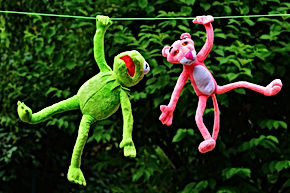 Kermit and Pink Panther hanging from a telephone wire