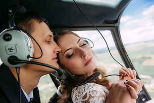 Bride and groom on helicopter getaway car from CE Limo Line