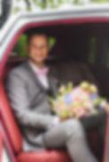 Groom in vintage wedding car