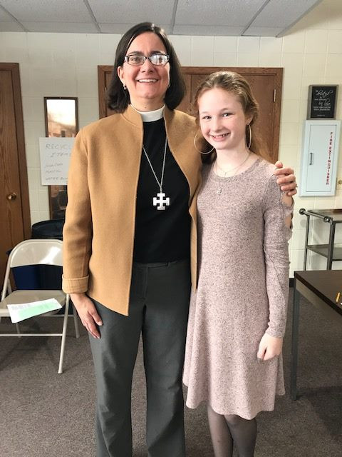 Pastor Rebecca with new member Abby
