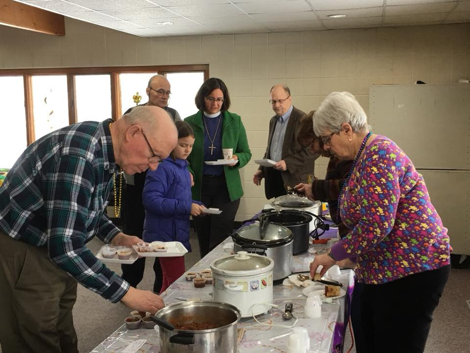 Members line-up for chili samples