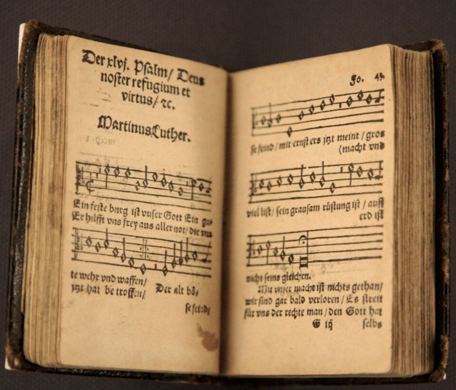 "Old hymnal open to ""A Mighty Fortress"" in German"