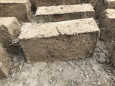 Noble Coyote Mezcal - Adobe brick made from bagazo