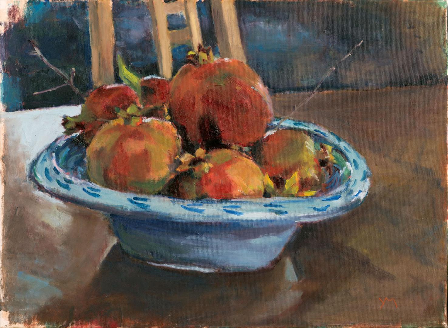 Pomegranates in a Spanish bowl