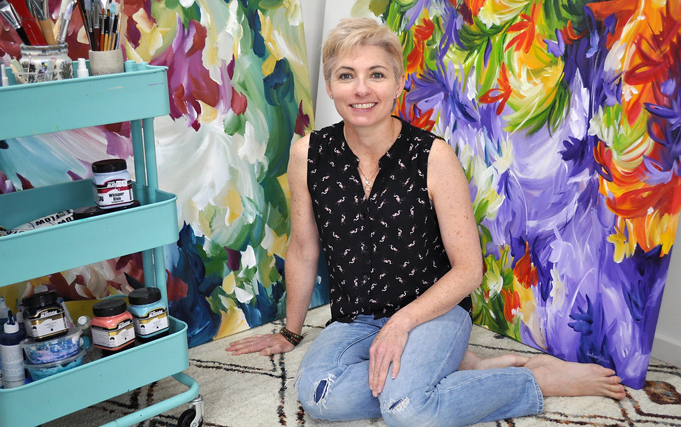 South Australian floral abstract artist Amber Gittins in her home art studio. Creating flower paintings and colourful floral abstracts for sale in her online gallery.