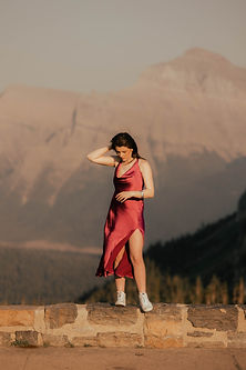 Miks photography is a photographer in Glacier national park a girl stand on rocks at logan pass in glacier park