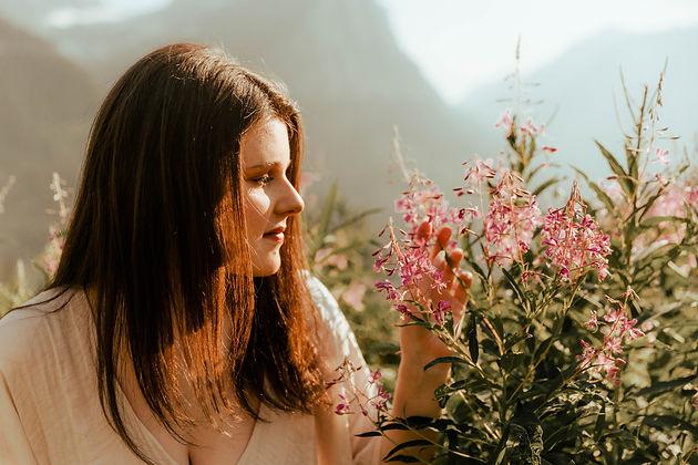 Senior photographer in glacier national park. Girl enjoying flowers at paridise meadow in glacier national park