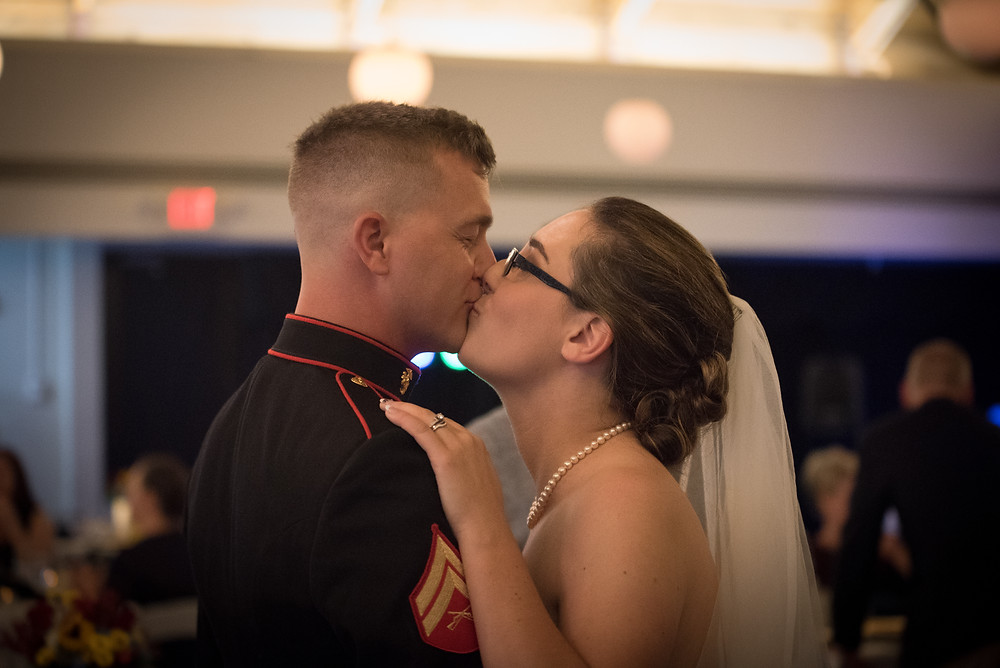 Sneaking a kiss at the wedding reception