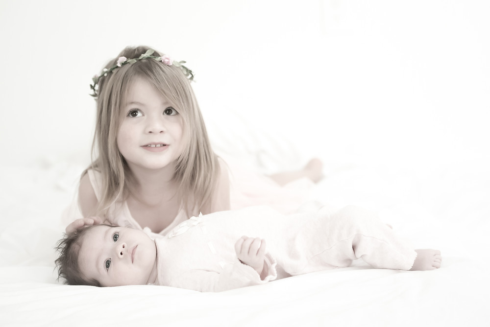 The girls laying on a mattress on my boutique studio floor in Sarasota