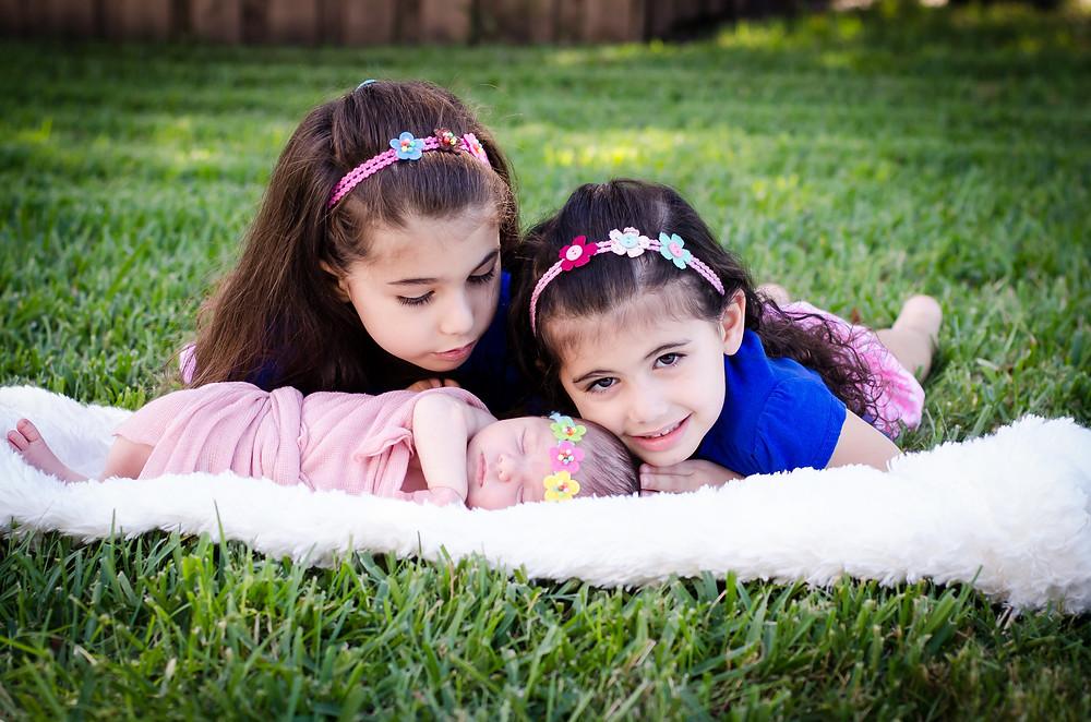 Olivia and Eleanor in their backyard Sarasota home.