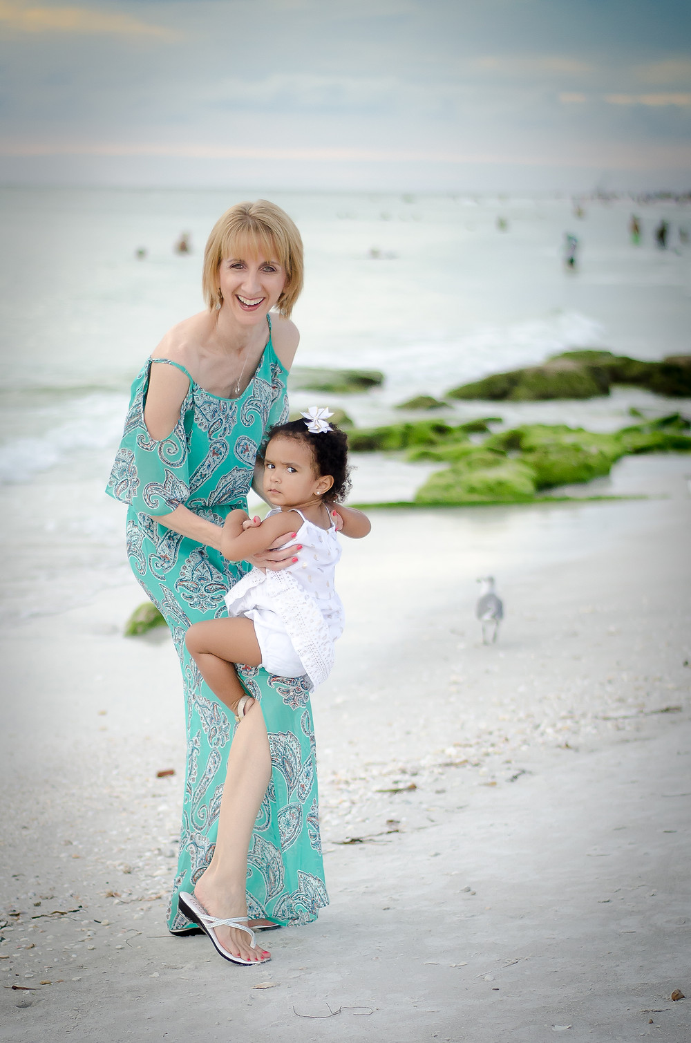 Madysen was not letting go of her mom for her photo session on the beach