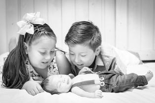 Newborn baby boy with cousins
