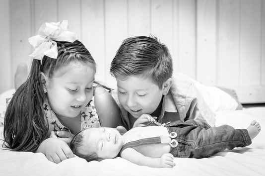 Newborn baby boy with cousins