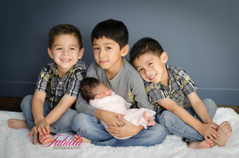 Newborn baby girl with brothers