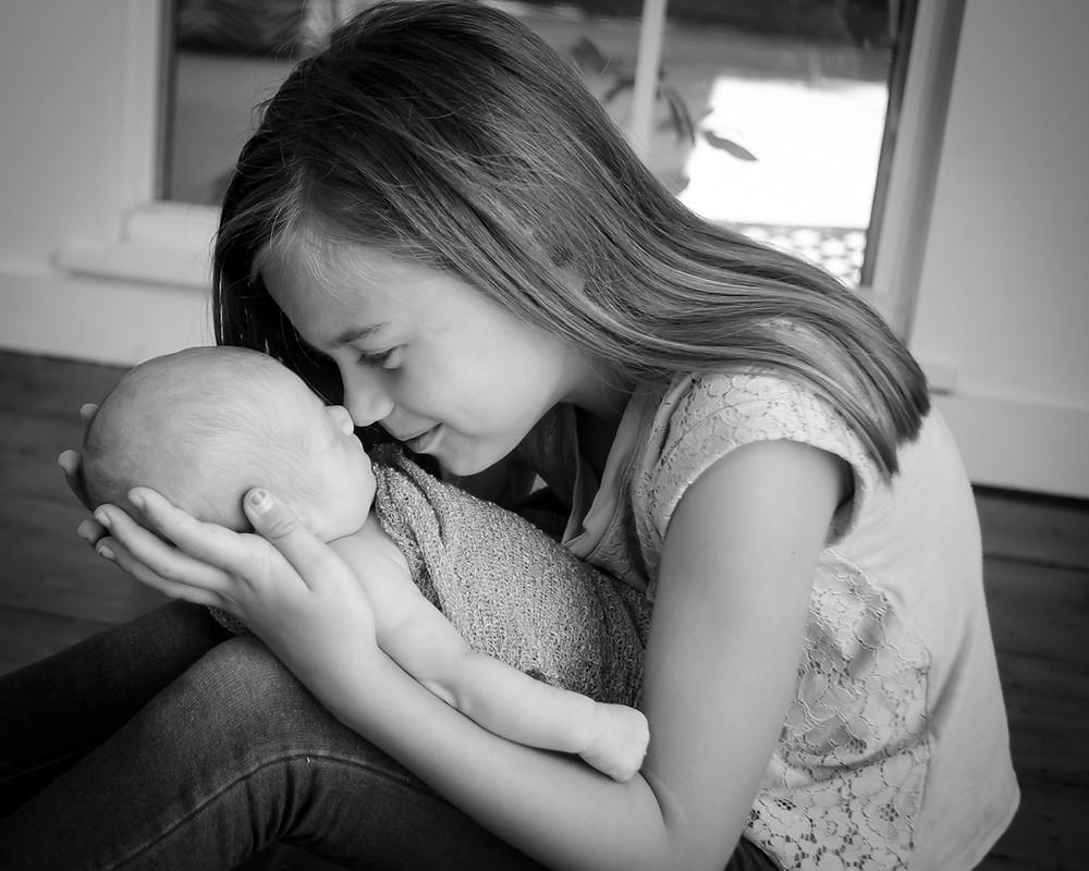 newborn baby with big sister