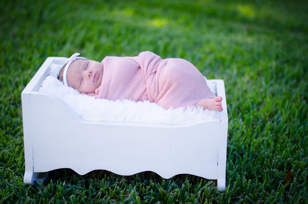 Baby Beatrice loving the baby doll bed I brought to the shoot.