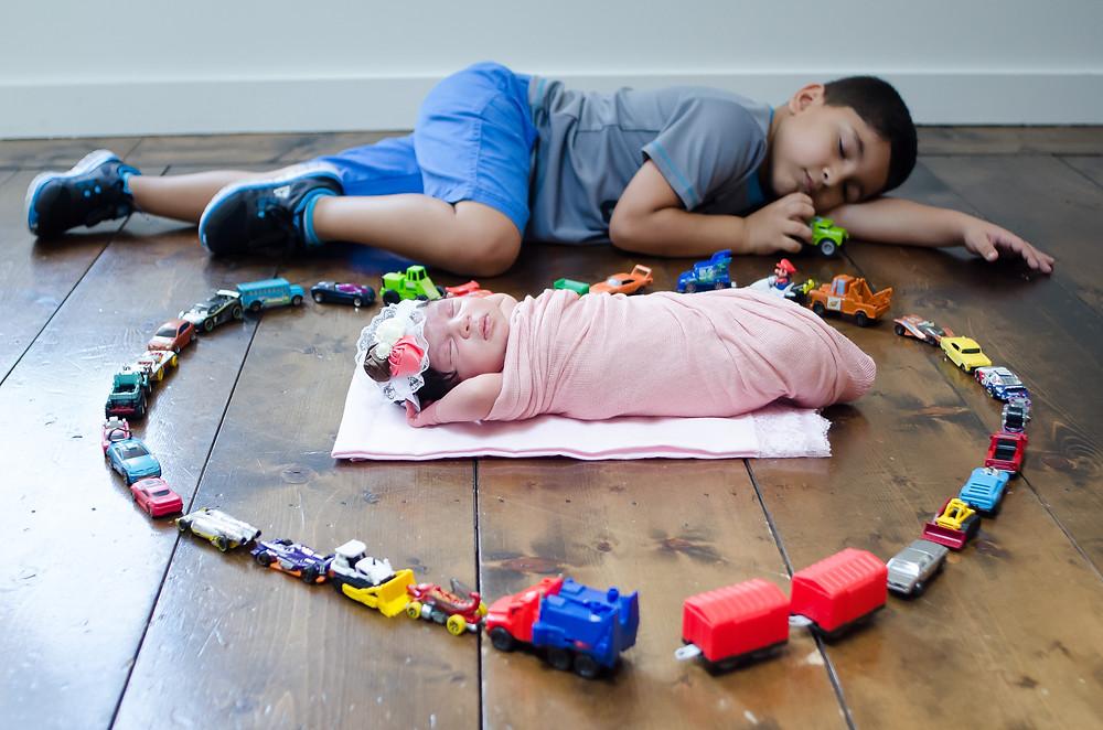 Siblings with big brothers toys in Sarasota Studio