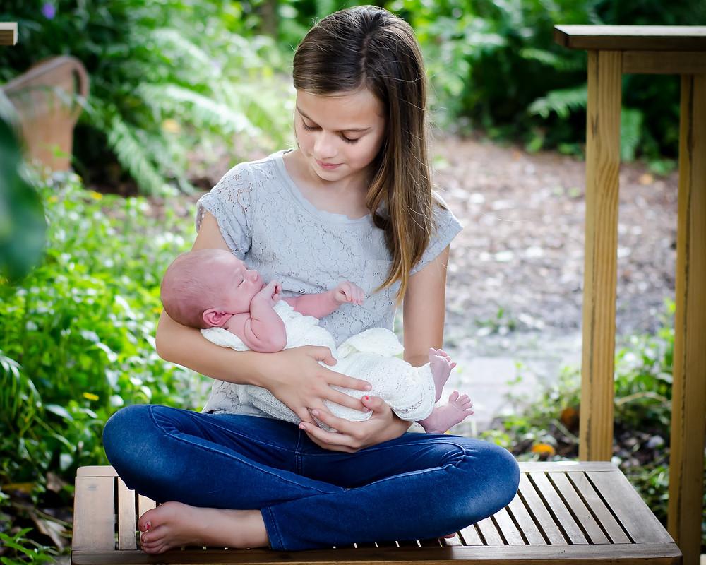 newborn baby with big sis in Sarasota