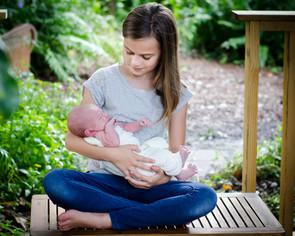 Newborn baby boy with sister