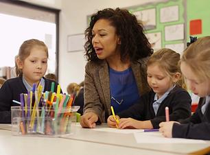videoblocks-4k-primary-school-children-drawing-in-the-classroom-with-teacher-helping_bzijs