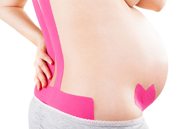 Beautiful pregnant woman with kinesio tape on her back. Back pain in pregnancy, alternativ