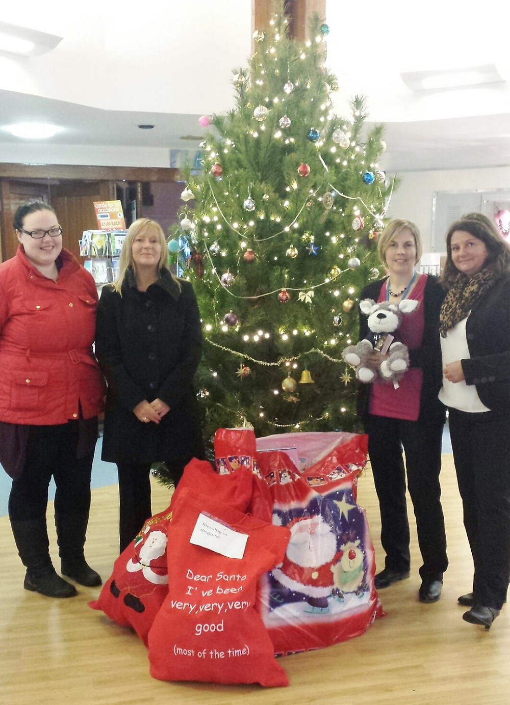 Under the Christmas tree at St Ann's Hospice.jpg