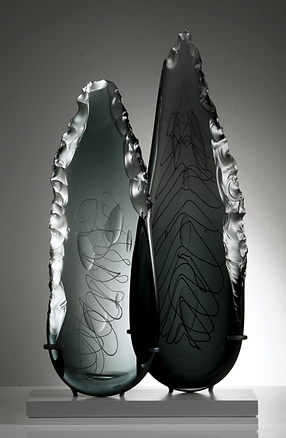 Tribal inspired contemporary art sculpture carved glass
