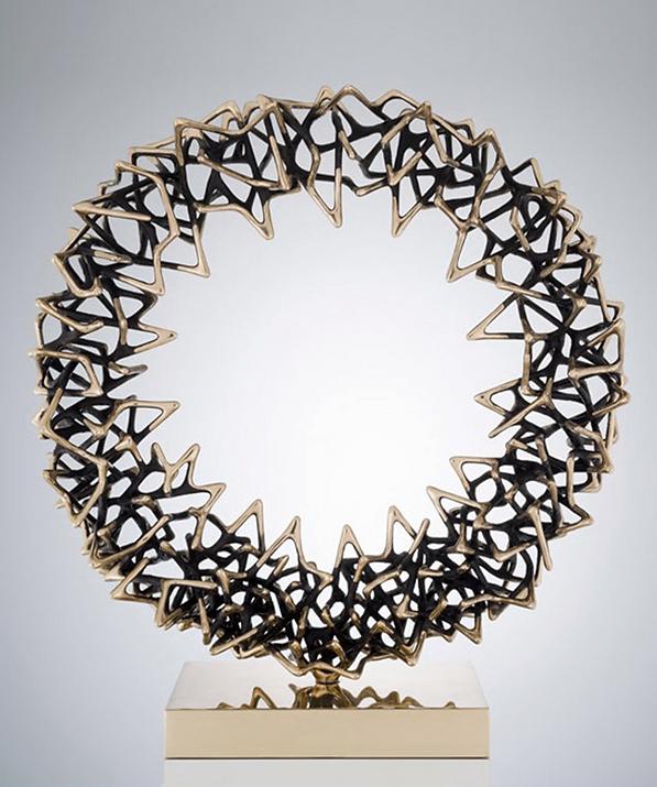 Contemporary circular cast bronze sculpture for interiors