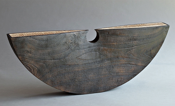 tribal inspired carved wood contemporary sculpture